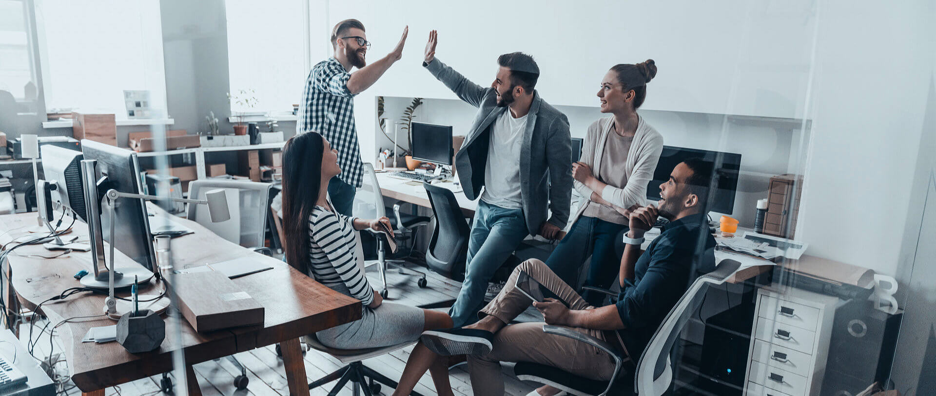 group of business people giving high five